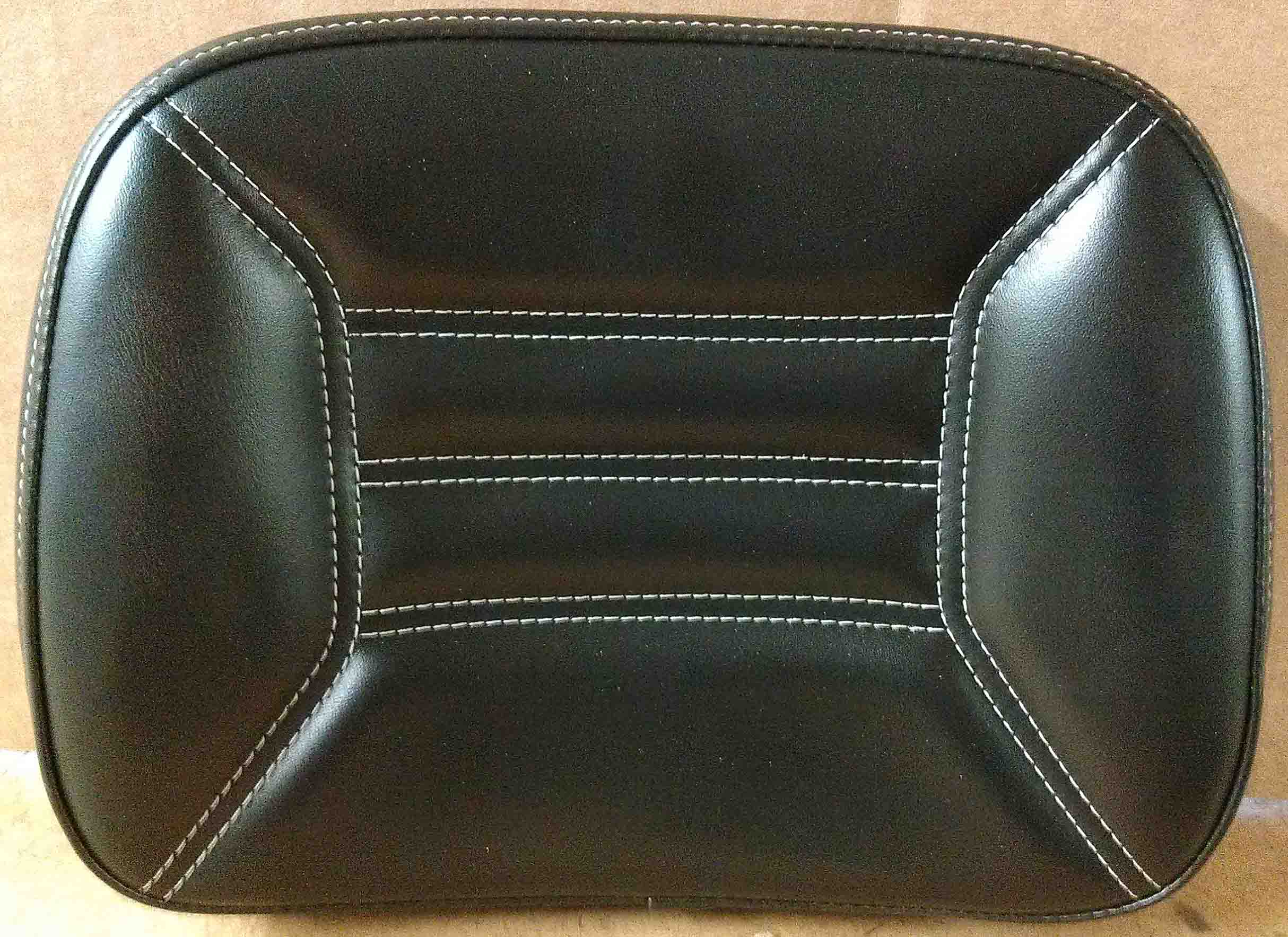 The entire backrest center and wings in this option is made with one black material to match the center material of the stock passenger backrest